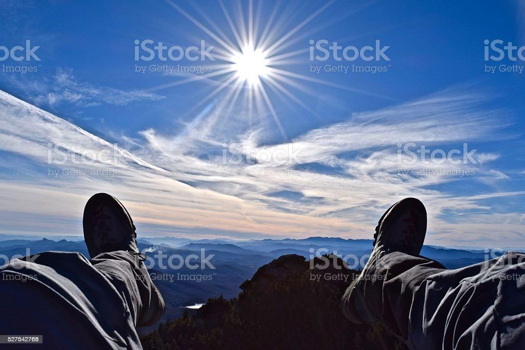 Feet hanging over the Blue Ridge Mountains stock photo