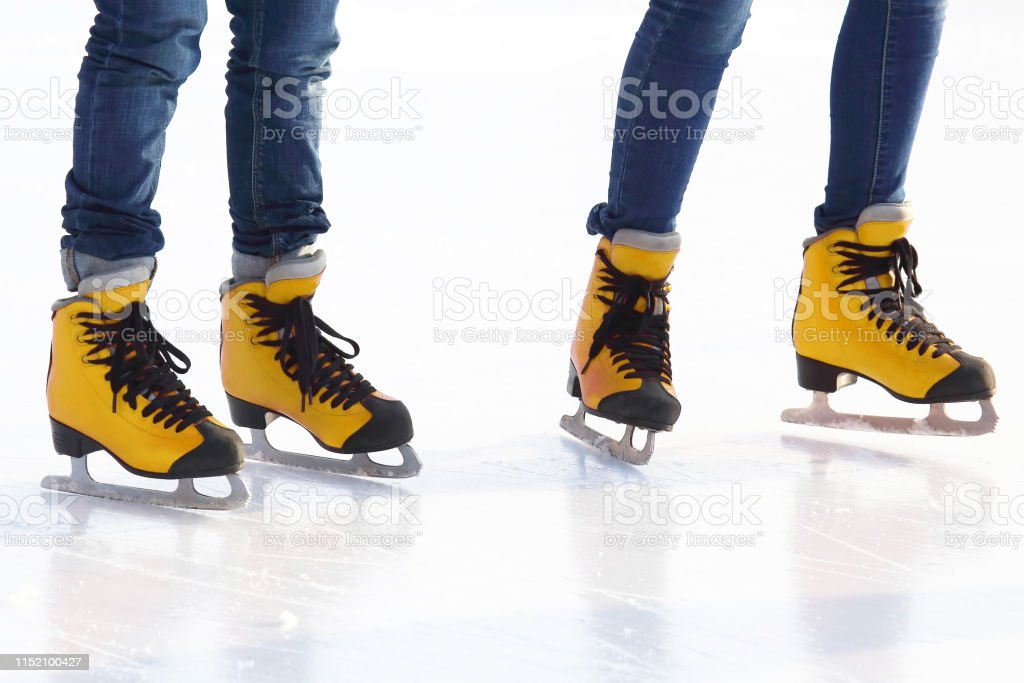 feet in skates on an ice rink. Hobbies and recreation. Sports and...