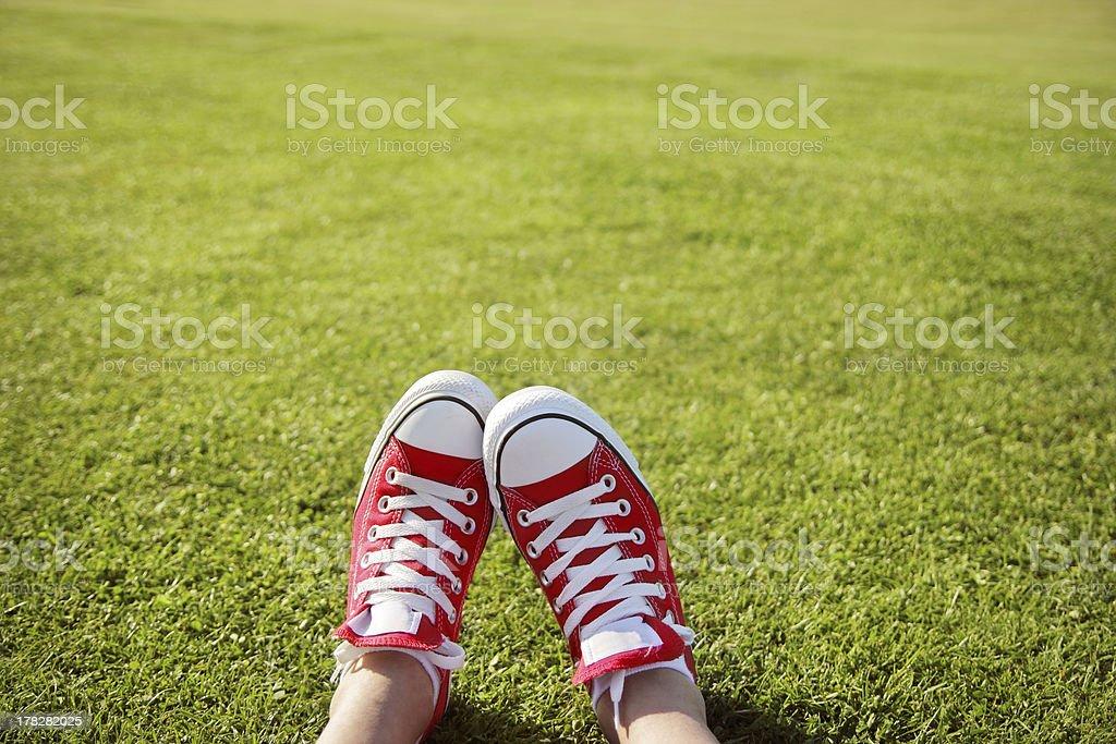 Feet in sneakers stock photo