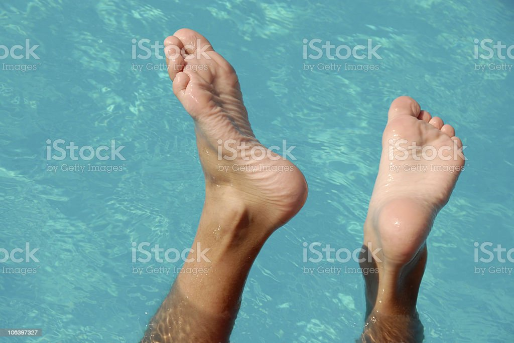Feet in swimming pool royalty-free stock photo