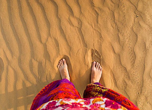 Feet in the desert stock photo