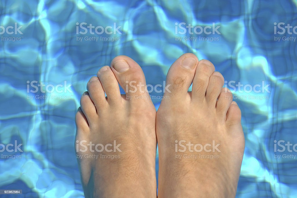 Feet in water on swimming pool royalty-free stock photo