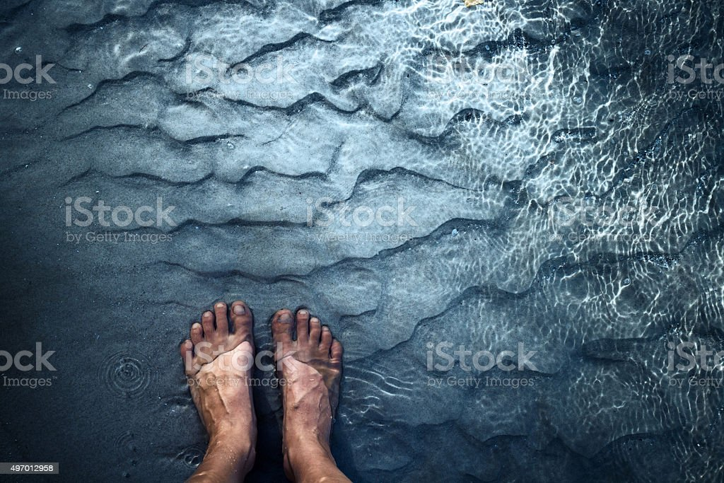 Feet in water stock photo