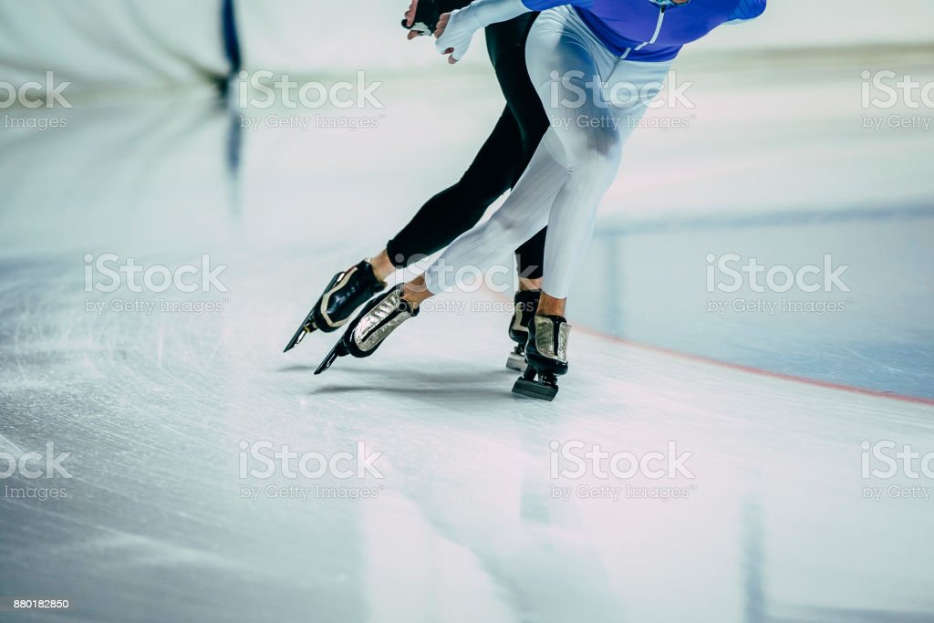 feet man athletes skater on ice go ice Palace of sports. competitions indoors. warm-up stock photo