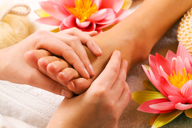 Feet massage  foot massage stock pictures, royalty-free photos & images