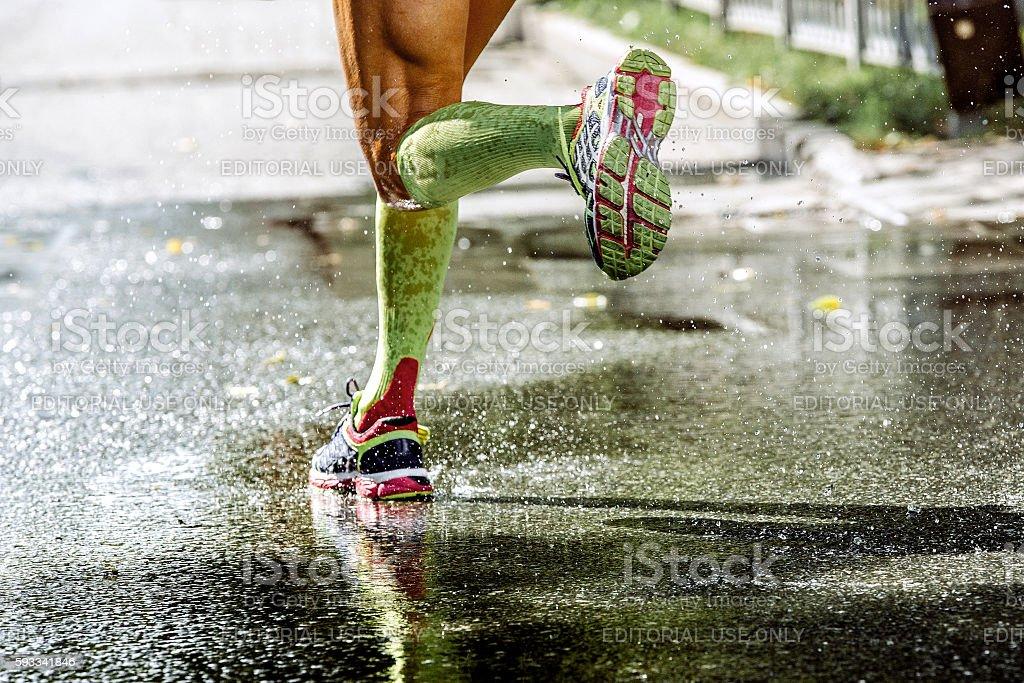 feet men runner compression socks stock photo