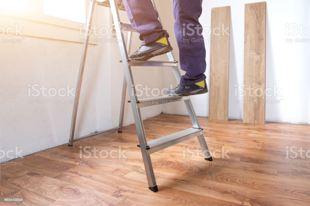 Outstanding Feet Of A Carpenter Ready For Work On A Ladder Stock Photo Machost Co Dining Chair Design Ideas Machostcouk