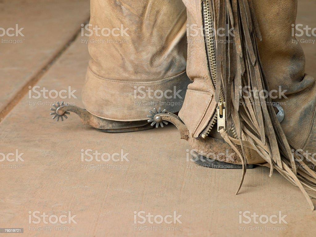 Feet of a cowboy 免版稅 stock photo