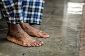 istock Feet of a nice African American man touching the floor 1136143781