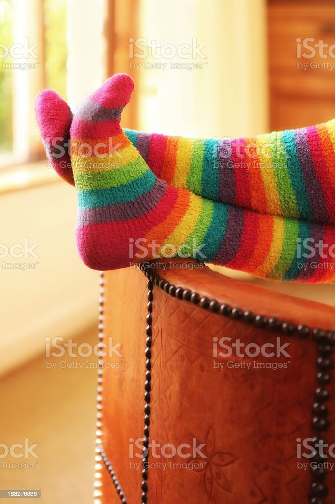 Feet of a person wearing rainbow socks while resting royalty-free stock photo