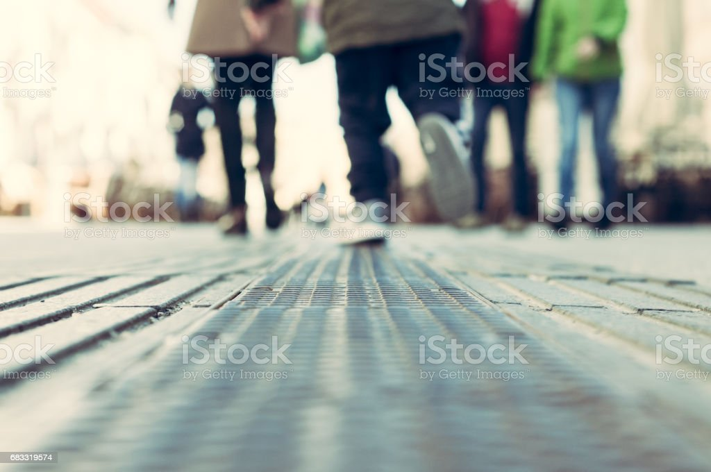 Feet of a running child. Blurred. Low point of view. Selective focus. Novi Sad, Serbia. royalty-free stock photo