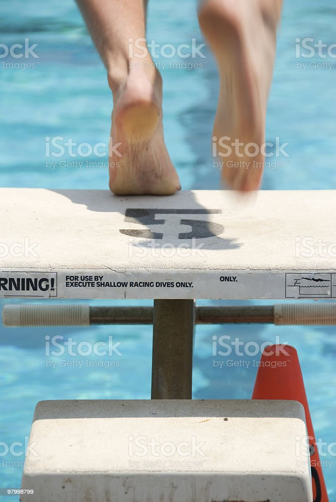 Feet of a swimmer leaving the block royalty-free stock photo