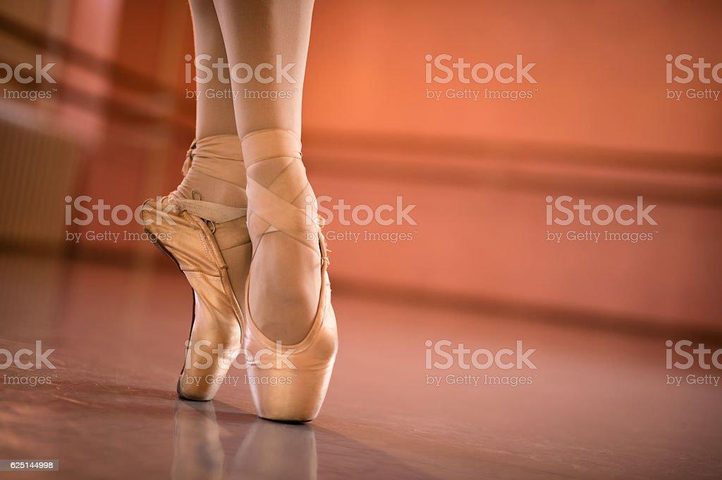 Feet of ballerina on tiptoe. stock photo