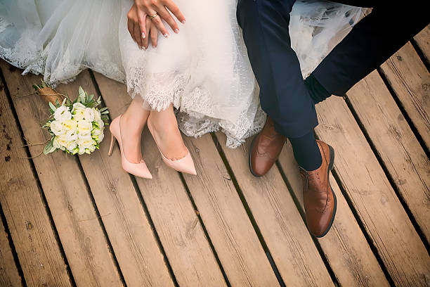 feet of bride and groom, wedding shoes (soft focus). - wedding stock pictures, royalty-free photos & images