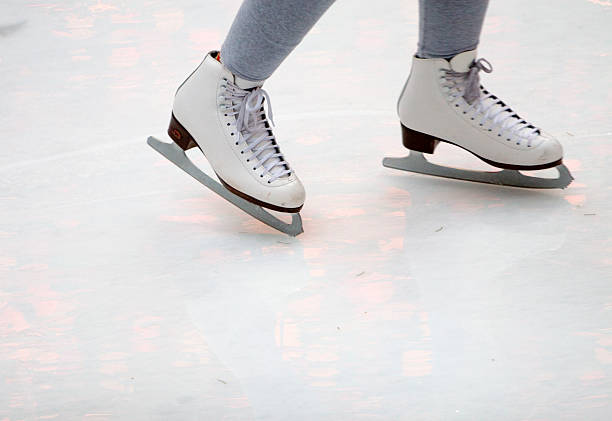 Feet of figure skater on ice stock photo