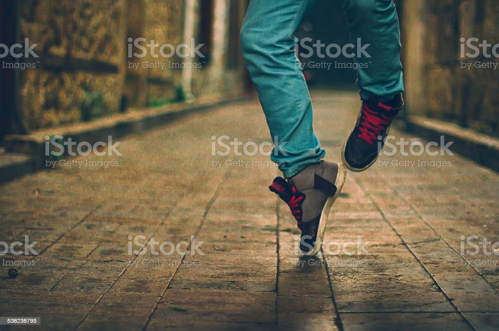 Feet  of hip-hop performer in sneakers stock photo