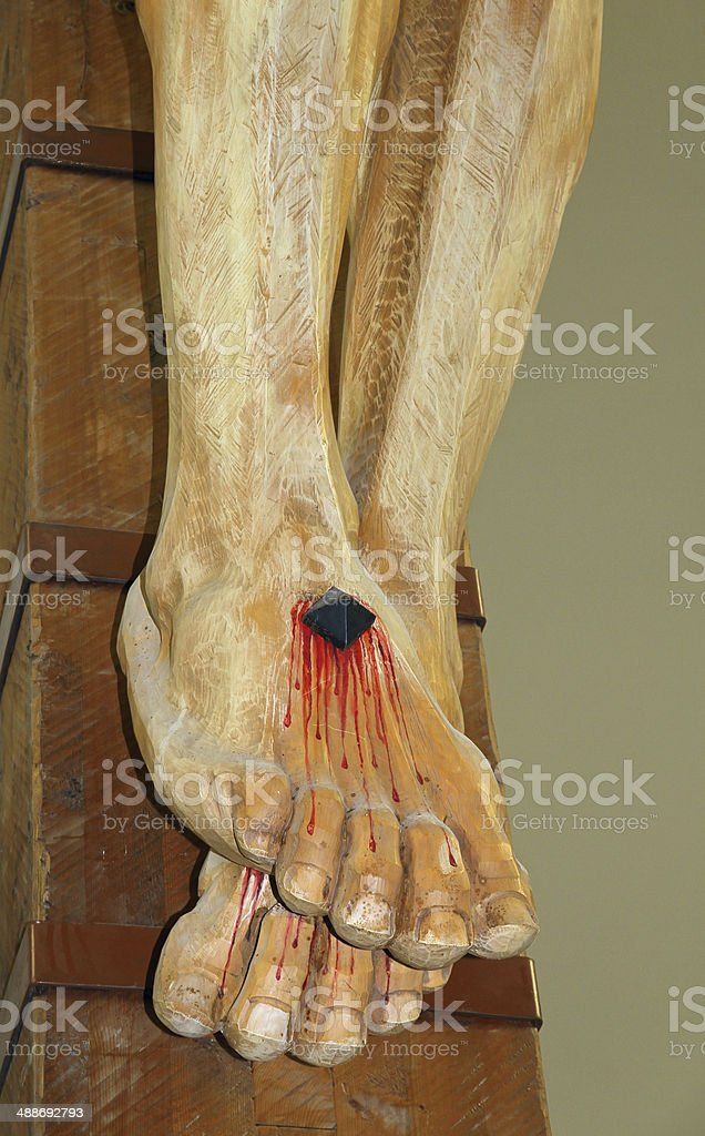 feet of Jesus Christ nailed to the cross stock photo