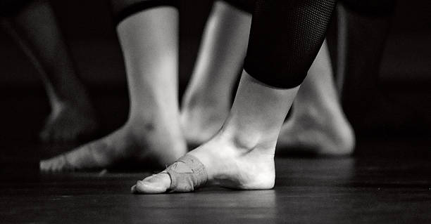 Feet of  lyrical dancers in black leggins stock photo