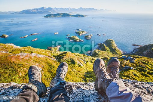 istock feet of people hikers relaxing on top of the mountain, travel background 880752764