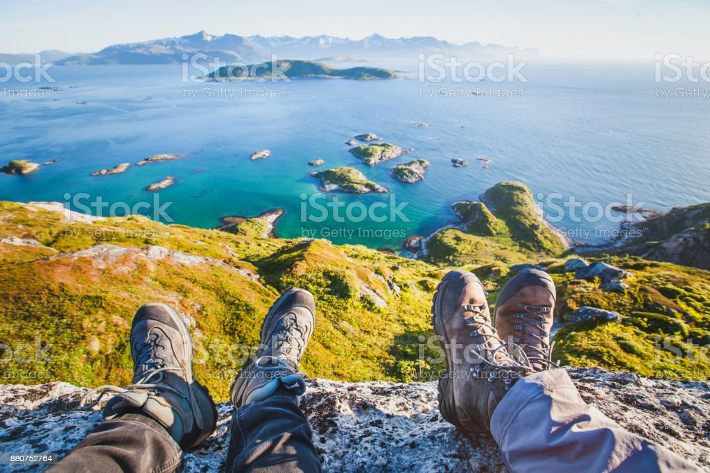feet of people hikers relaxing on top of the mountain, travel background stock photo