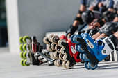 Feet of rollerbladers wearing inline roller skates sitting in outdoor skate park, Close up view of wheels befor city race for healthy and active life