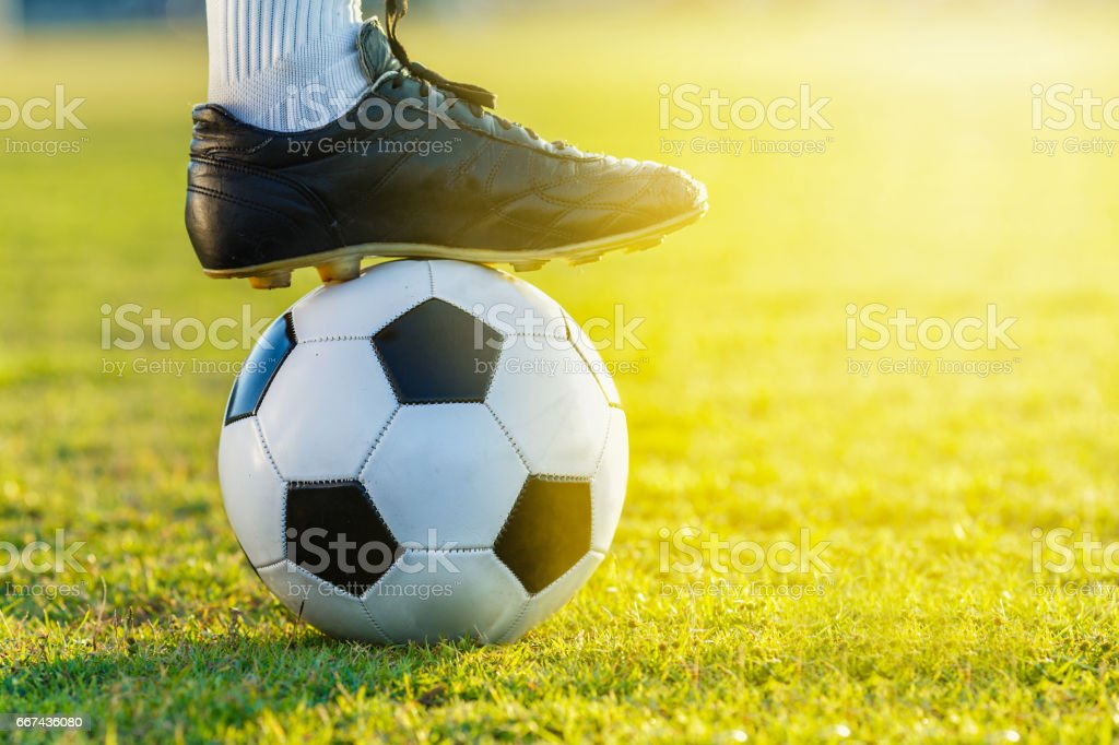 feet of soccer football player standing with the ball stock photo