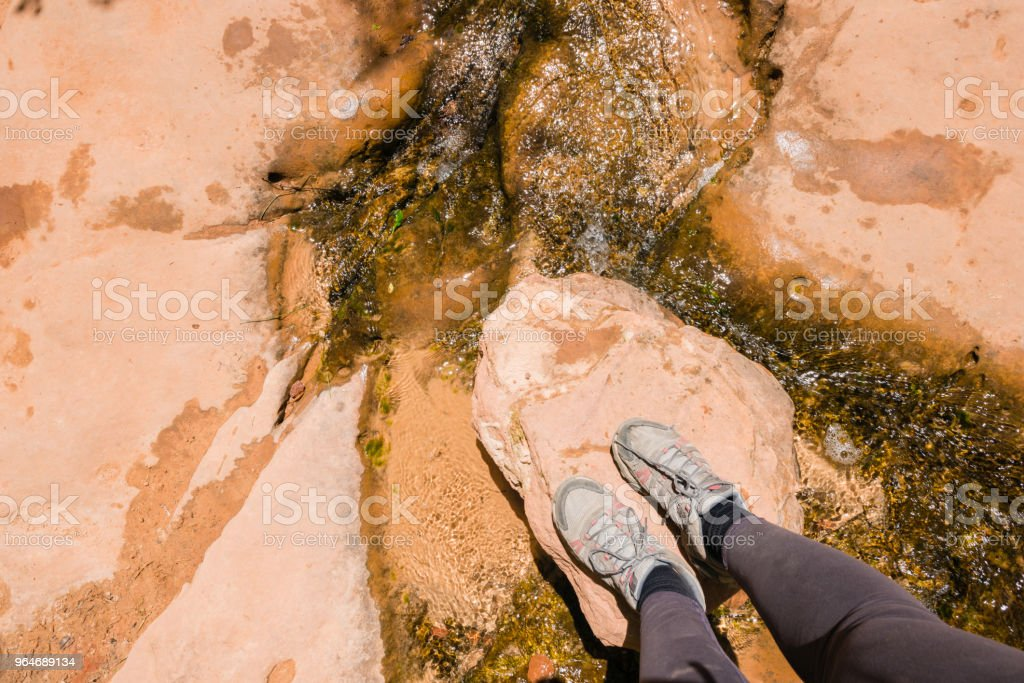 Feet of Woman Hiking Standing on Zion National Park Rock royalty-free stock photo