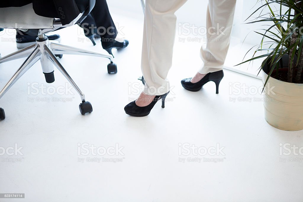 Feet of women who are working in high heels stock photo