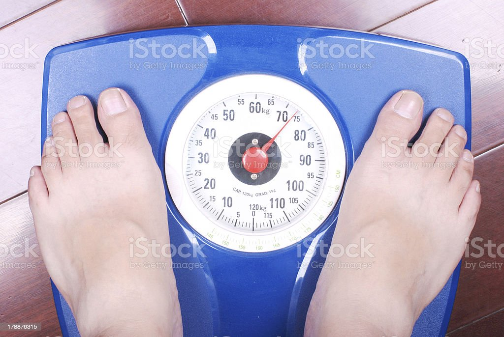 Feet on a bathroom scale royalty-free stock photo