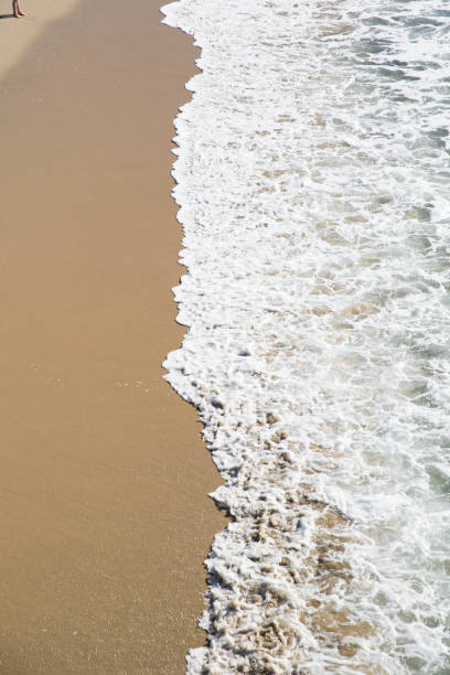 Feet on a Beach The shore from above jude beck stock pictures, royalty-free photos & images