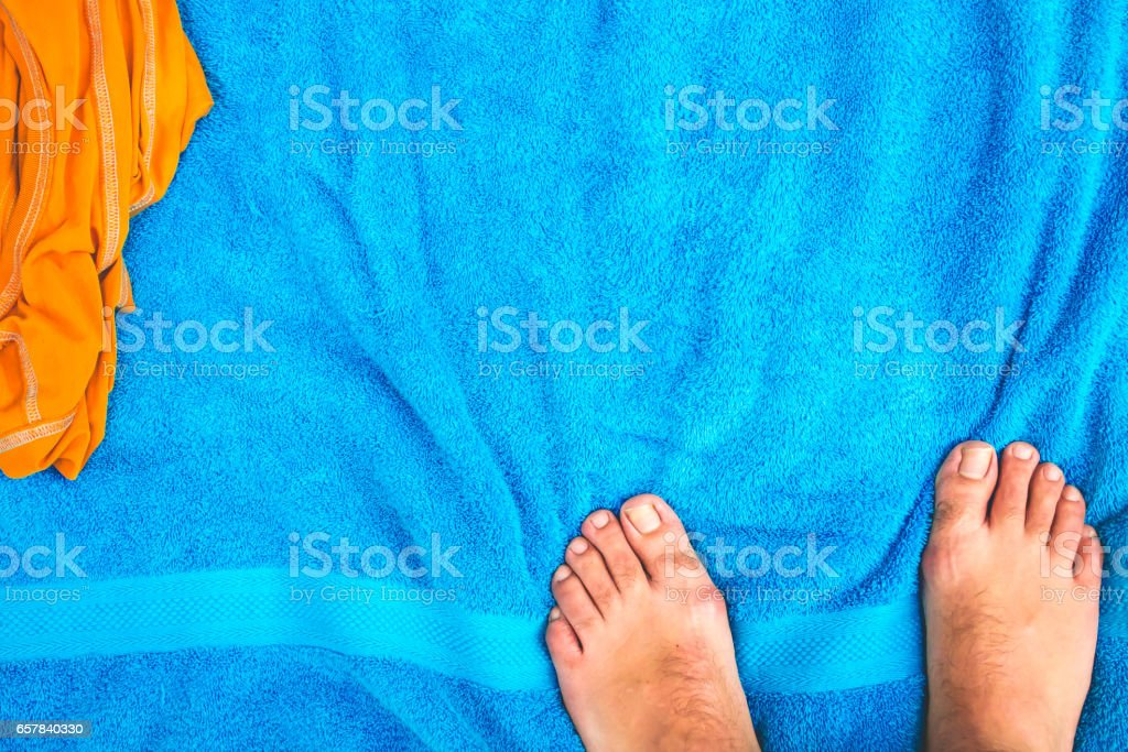 Feet on a blue towel stock photo