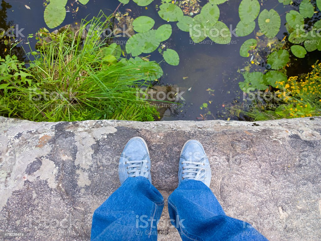 Feet on a rock. stock photo