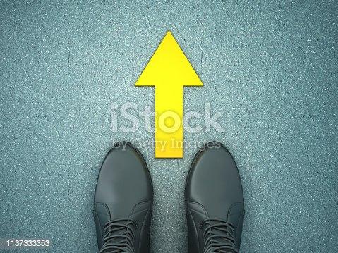 954712506istockphoto Feet on Asphalt Road with Arrow - 3D Rendering 1137333353