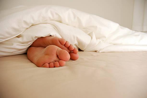 Feet On Bed stock photo