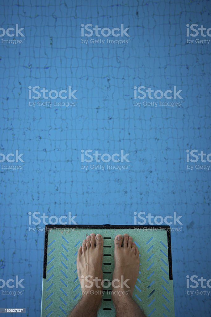 feet on diving board stock photo