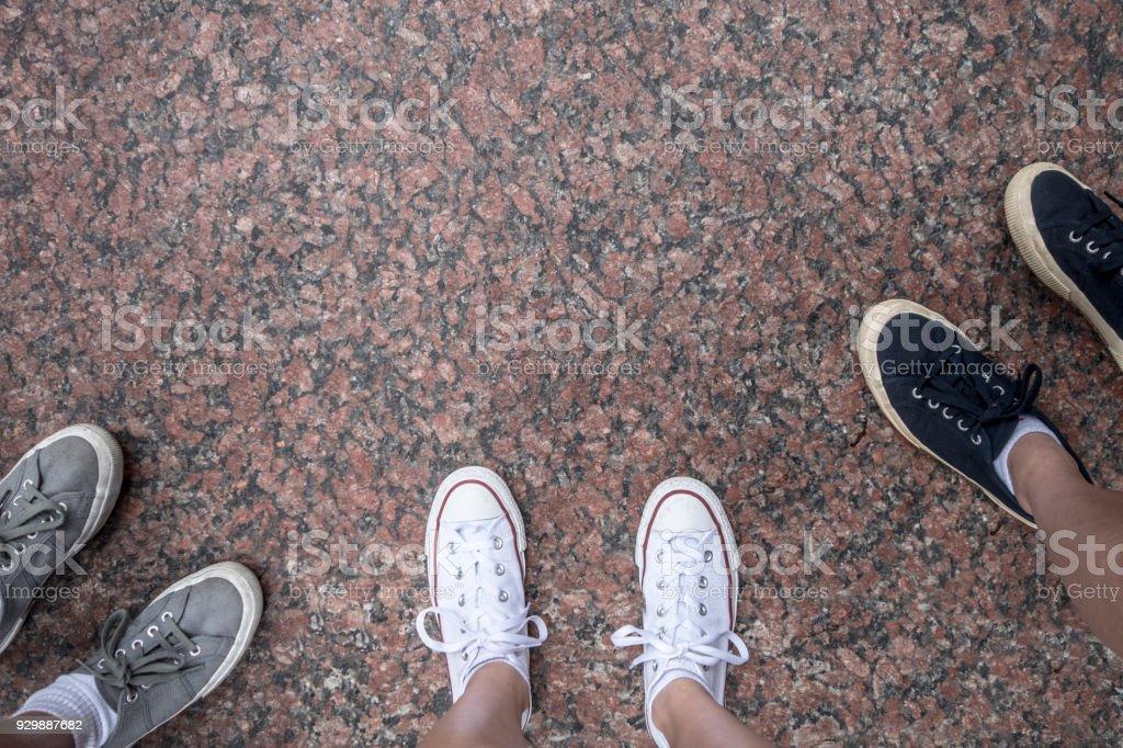 feet on grant rock surface stock photo