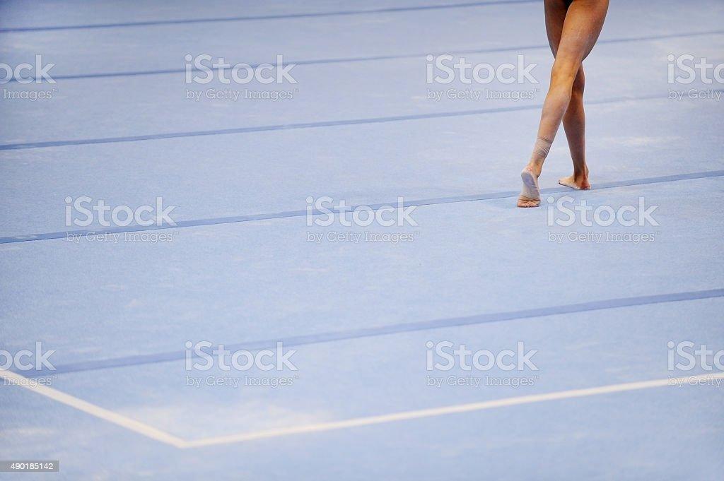 Feet on gymnastics floor stock photo