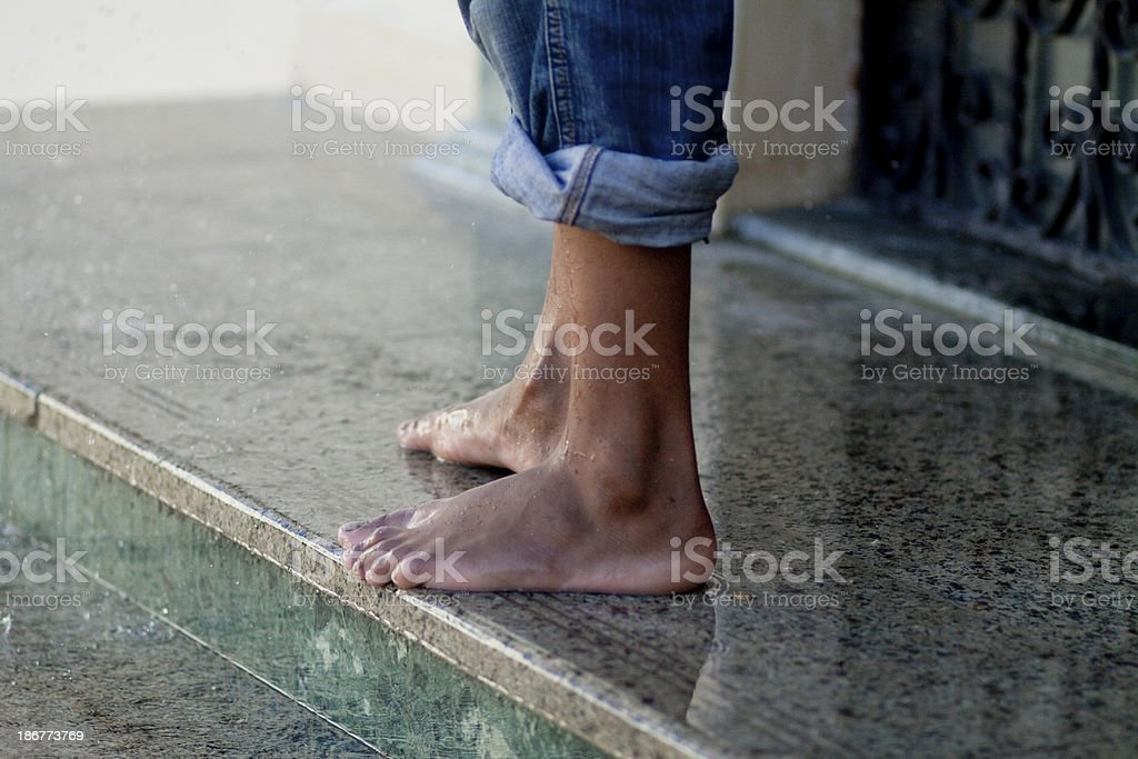 Feet on marble stairs stock photo