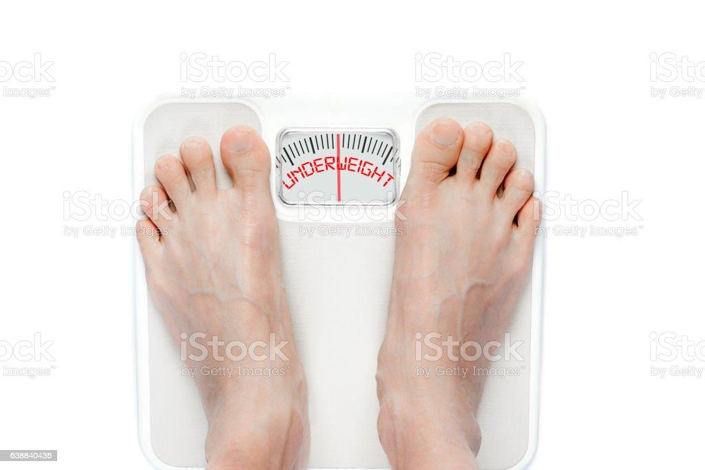 Feet on Mechanical Bathroom Scale Isolated on White - foto de stock