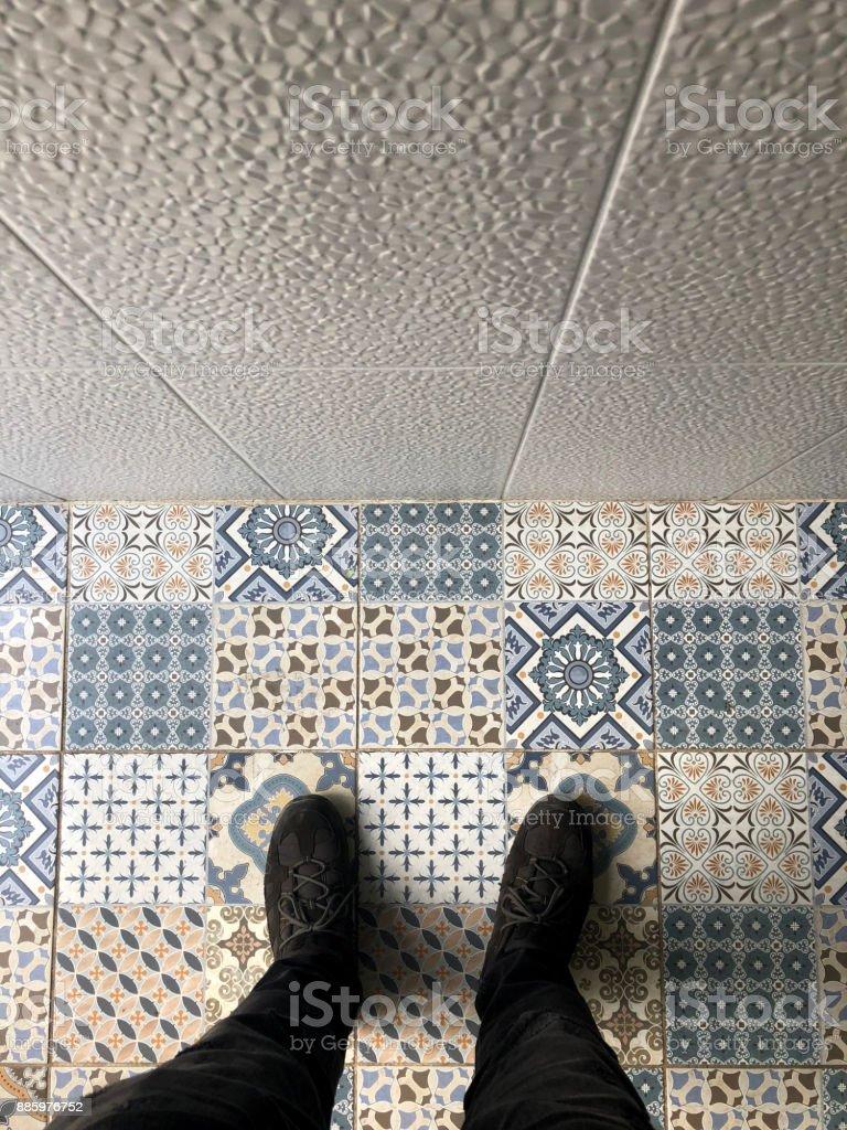 Feet on mosaic stock photo