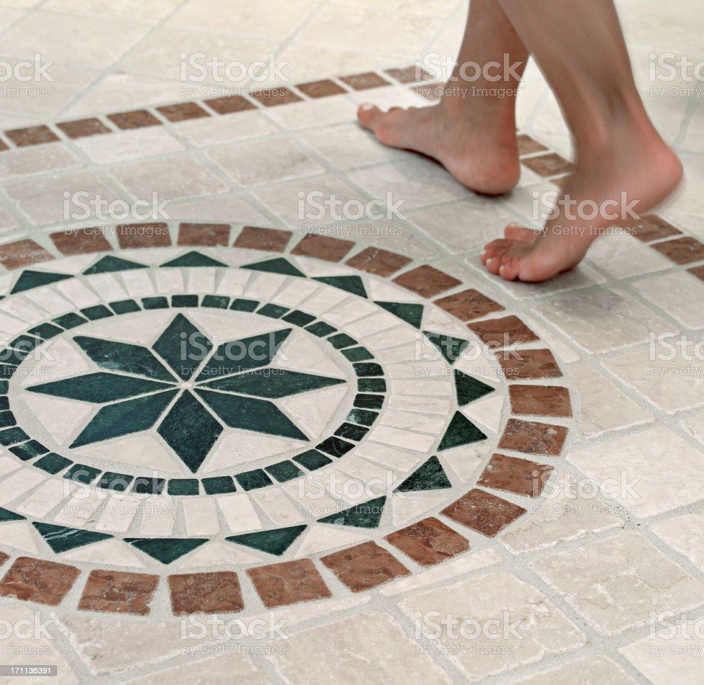 Feet on mosaics stock photo