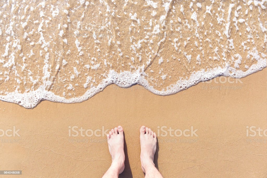 Feet on sea sand and wave, Vacation on ocean beach, Summer holiday. - Royalty-free Adult Stock Photo