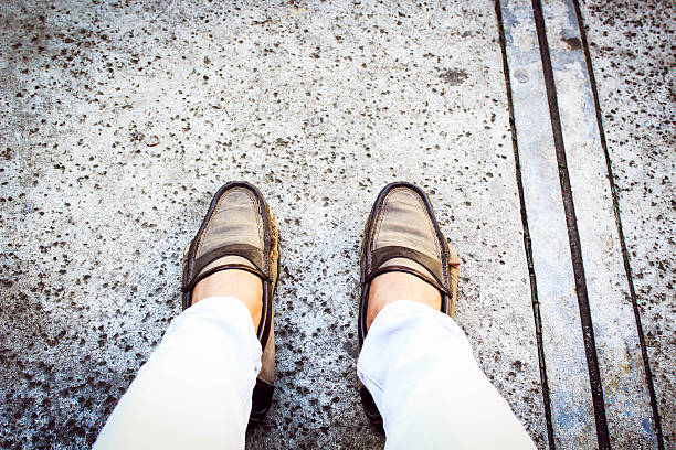 Feet on street looking down. stock photo
