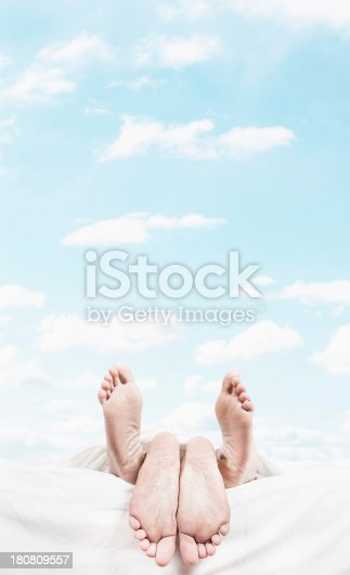 164979632istockphoto feet on the bed -  sex concept 180809557