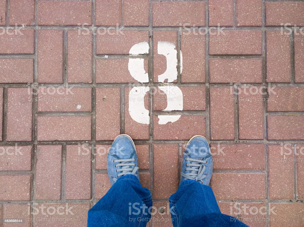 Feet on the cobblestone. stock photo