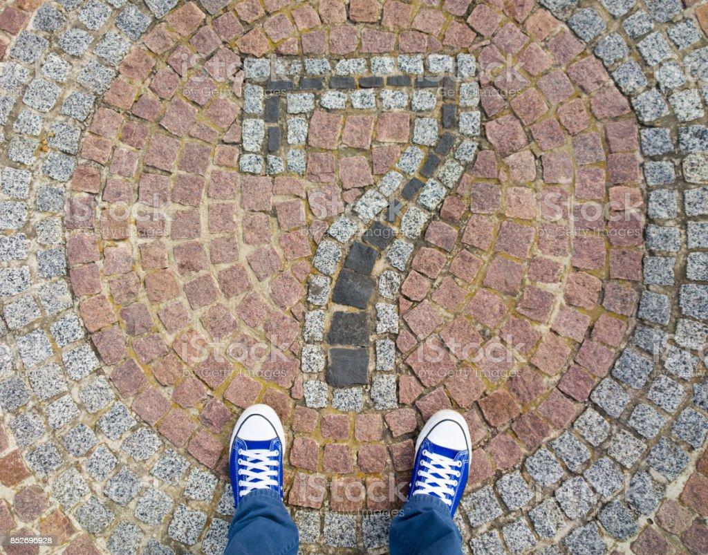 Feet on the cobblestone. stock photo