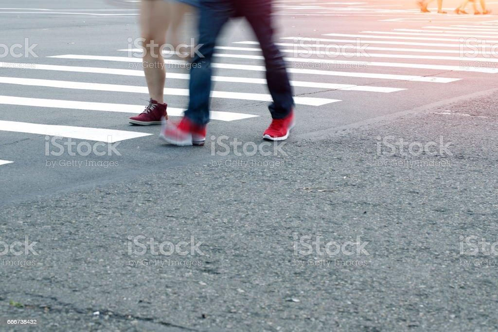Feet on the pedestrian zebra crossing foto stock royalty-free