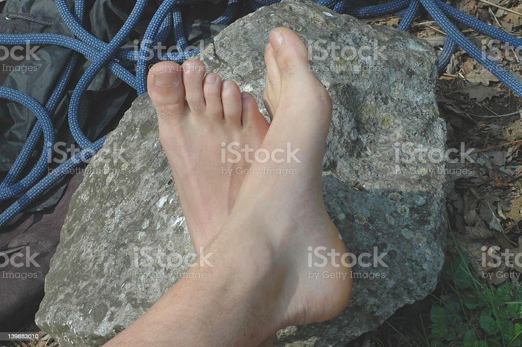 feet on the rocks royalty-free stock photo