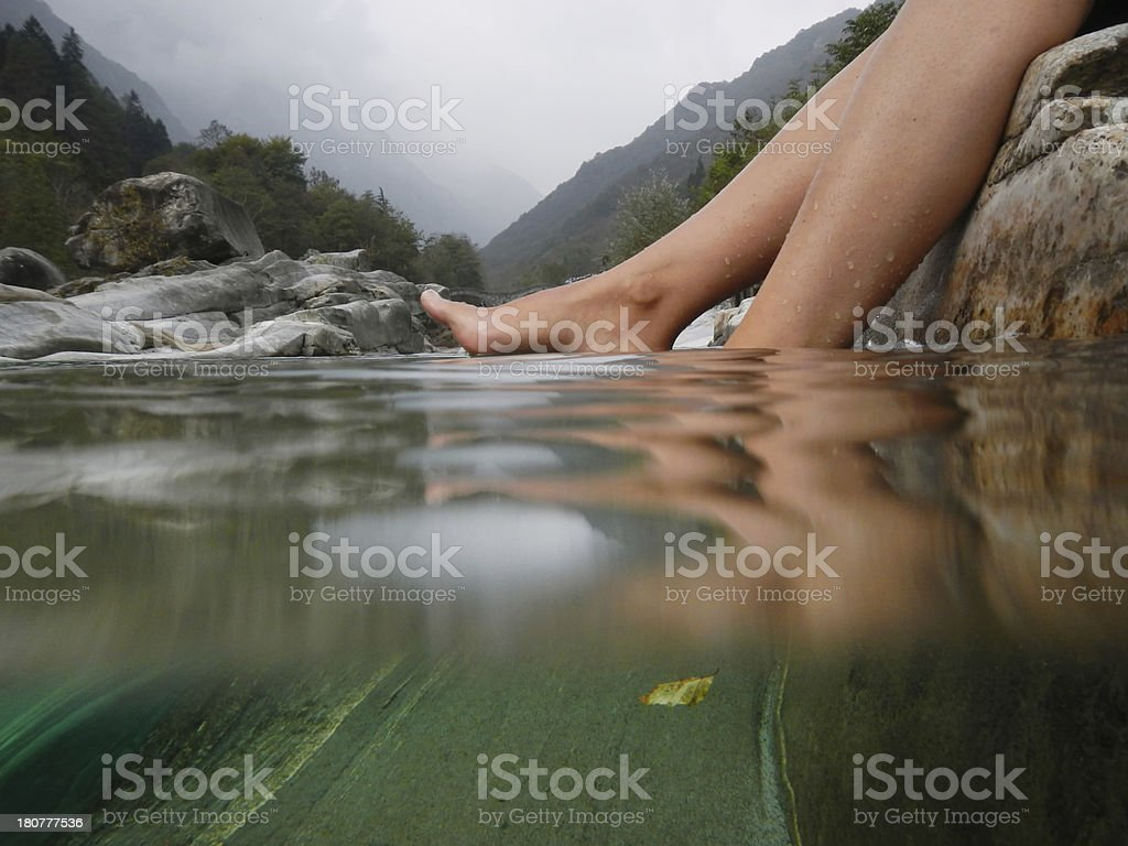 Feet on the water stock photo