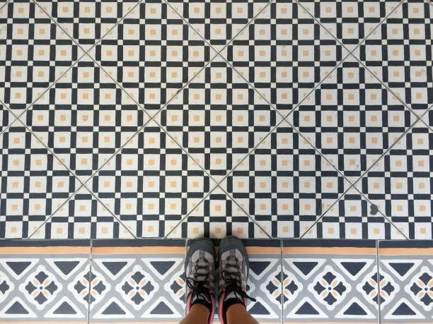 Feet on tiled floor
